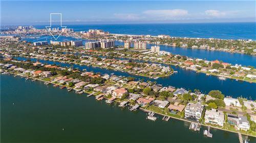 Photo of 644 ISLAND WAY #407, CLEARWATER, FL 33767 (MLS # U8131446)