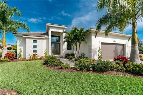 Photo of 1310 TUSCANY DR, PUNTA GORDA, FL 33950 (MLS # C7425450)