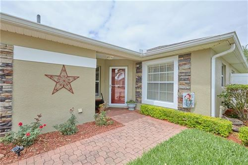 Photo of 3412 GRENVILLE DR, WINTER HAVEN, FL 33884 (MLS # P4910451)