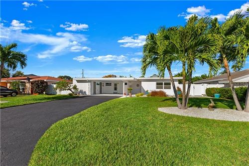 Photo of 10112 PARADISE BOULEVARD, TREASURE ISLAND, FL 33706 (MLS # U8072453)