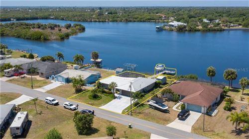 Photo of 290 SPRING LAKE BOULEVARD NW, PORT CHARLOTTE, FL 33952 (MLS # C7441457)