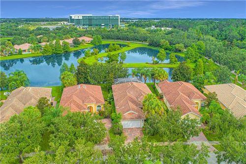 Photo of 11842 GENNARO LANE, ORLANDO, FL 32827 (MLS # O5880460)