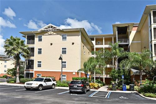 Photo of 9051 TREASURE TROVE LANE #303, KISSIMMEE, FL 34747 (MLS # O5918460)