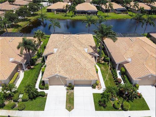 Photo of 8215 EAGLE ISLES PLACE, BRADENTON, FL 34212 (MLS # A4472465)