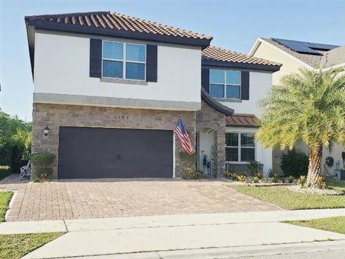 Photo of 3279 PALATKA STREET, ORLANDO, FL 32824 (MLS # O5942468)