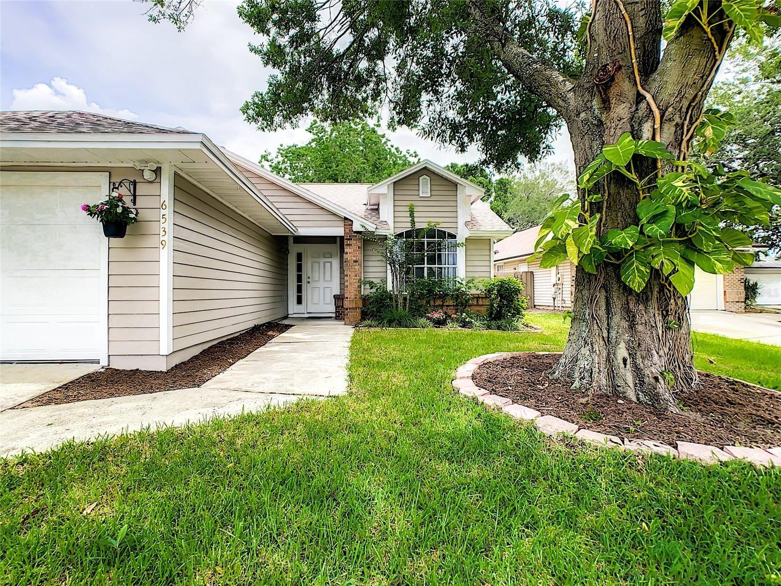 Photo of 6539 PICCADILLY LANE, ORLANDO, FL 32835 (MLS # O5952476)