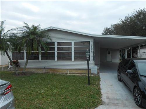 Photo of 6607 WESTCHESTER DRIVE NE, WINTER HAVEN, FL 33881 (MLS # L4914481)