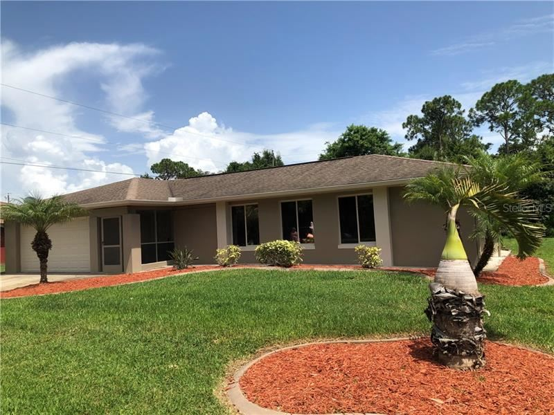 Photo of 947 SILVER SPRINGS TERRACE NW, PORT CHARLOTTE, FL 33948 (MLS # C7430483)