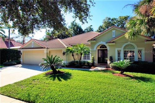 Photo of 1048 SURREYWOOD LANE, LAKE MARY, FL 32746 (MLS # O5825490)