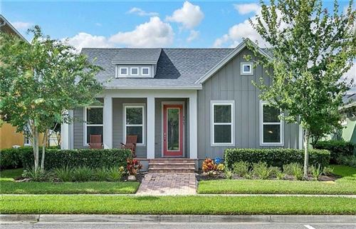 Photo of 8667 LAUREATE BOULEVARD, ORLANDO, FL 32827 (MLS # O5913491)