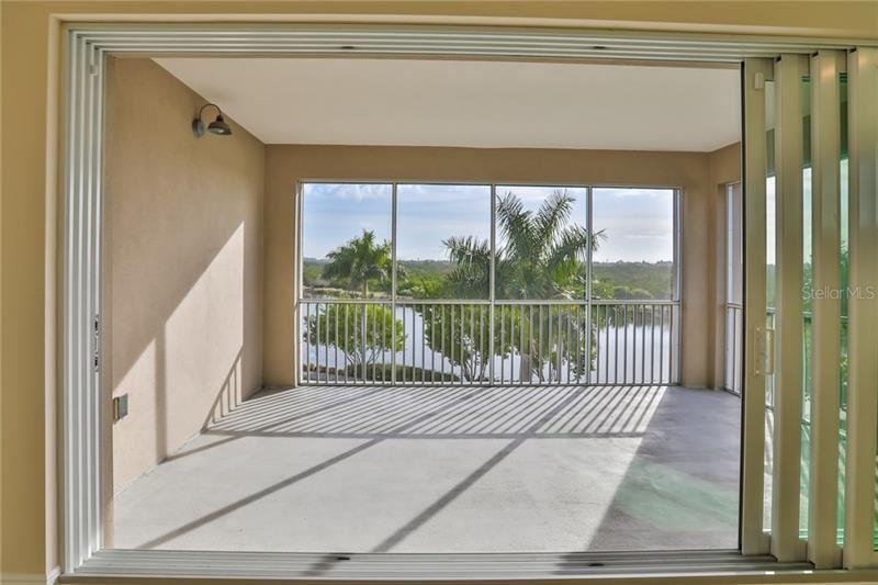 Photo of 395 ARUBA CIRCLE #303, BRADENTON, FL 34209 (MLS # O5854502)