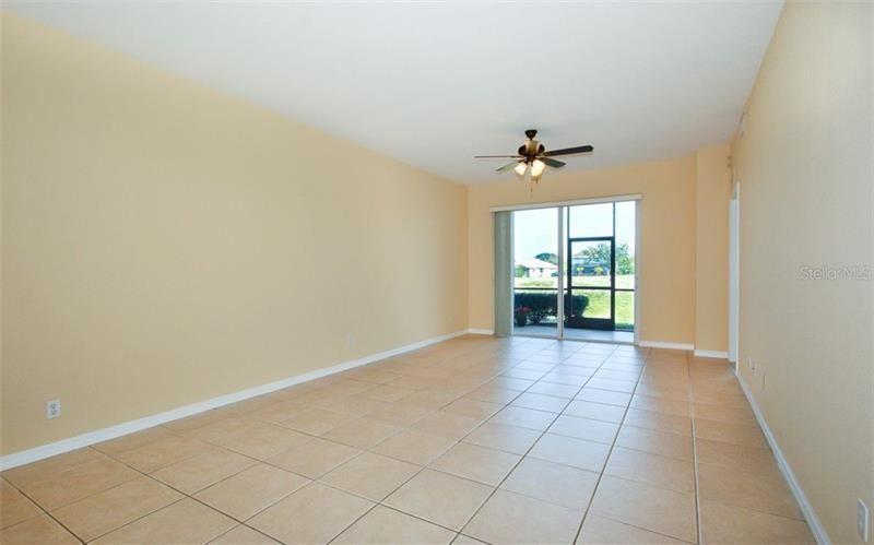 Photo of 905 FAIRWAYCOVE LANE #105, BRADENTON, FL 34212 (MLS # A4488503)