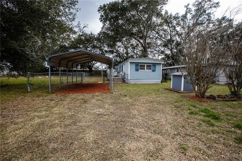 Photo of 6385 COUNTY ROAD 154A, WILDWOOD, FL 34785 (MLS # G5038511)
