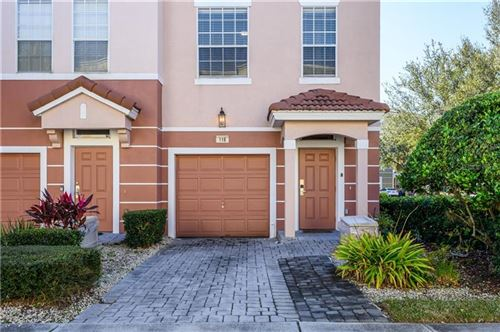 Photo of 8013 COOL BREEZE DRIVE #116, ORLANDO, FL 32819 (MLS # O5832513)