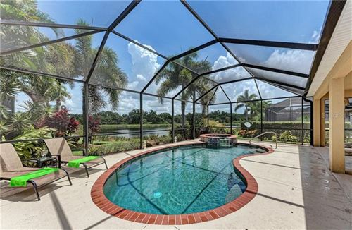 Photo of 9007 HAMMOCK EDGE PLACE, BRADENTON, FL 34212 (MLS # A4471514)