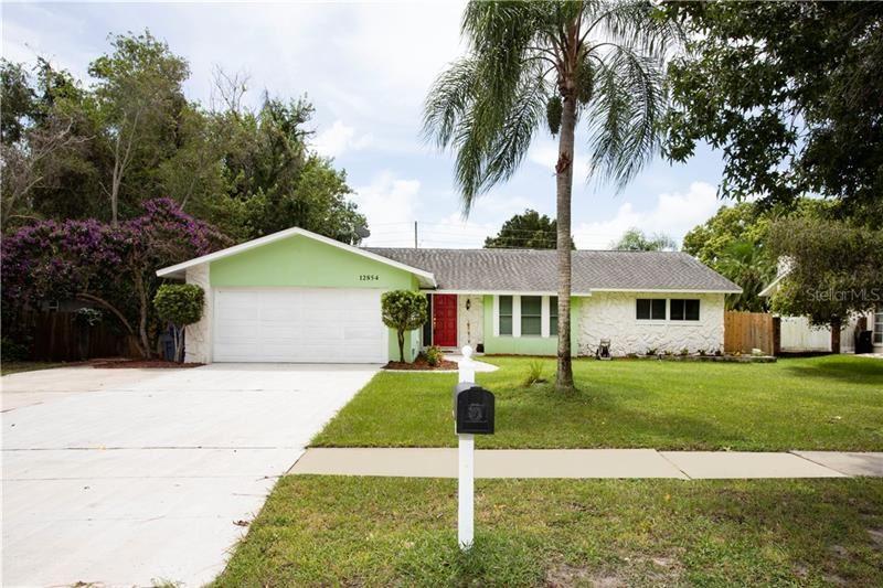12854 LOIS AVENUE, Seminole, FL 33776 - #: U8096514