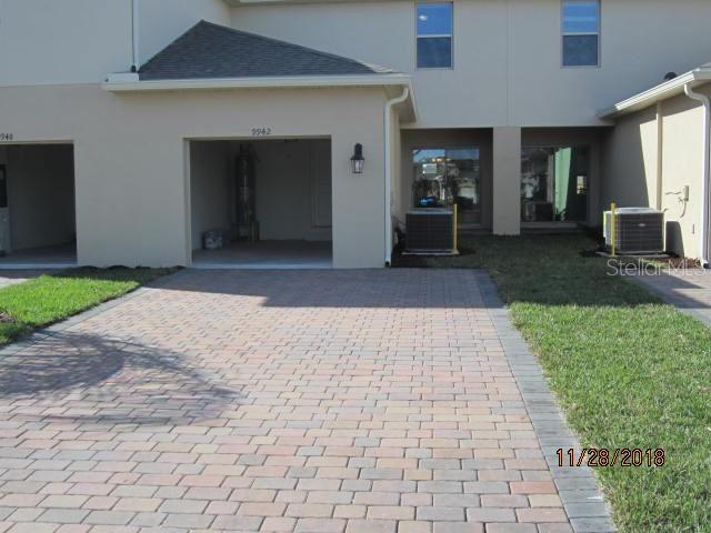 Photo of 9942 SUNNY MEWS ALLEY, WINTER GARDEN, FL 34787 (MLS # S5045519)