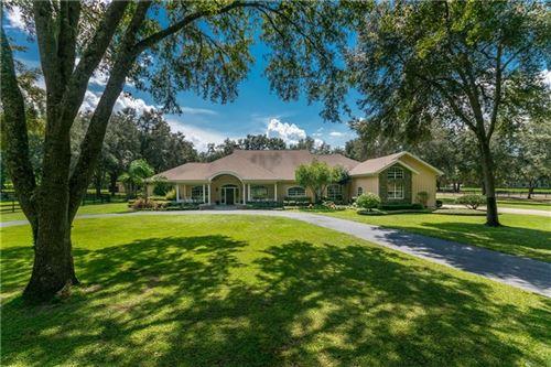 Photo of 1715 NW 114TH LOOP, OCALA, FL 34475 (MLS # OM609532)
