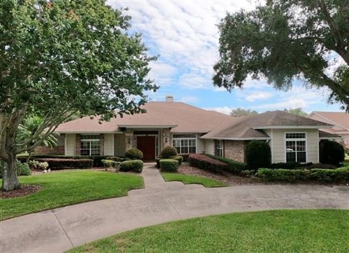 Photo of 8209 COURTLEIGH DRIVE, ORLANDO, FL 32835 (MLS # O5882533)