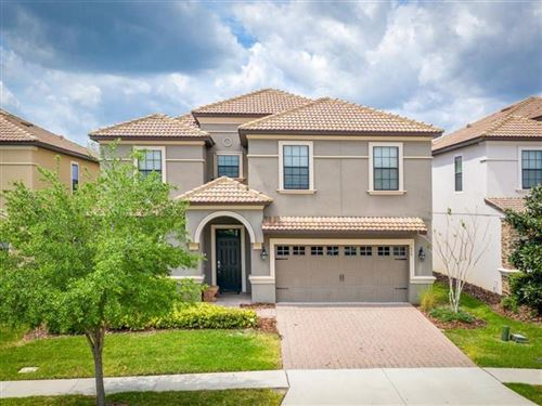 Photo of 1479 ROLLING FAIRWAY DR, CHAMPIONS GATE, FL 33896 (MLS # O5854535)
