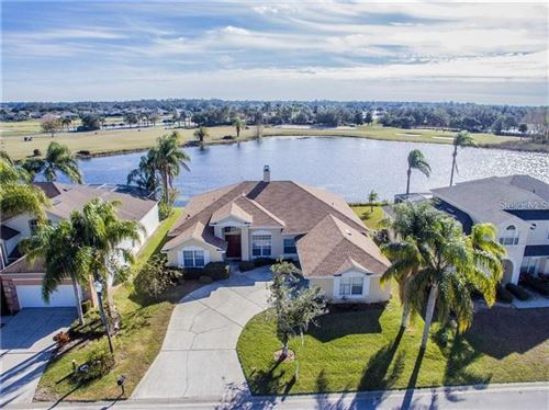 Photo of 734 GOLF COURSE PARKWAY, DAVENPORT, FL 33837 (MLS # O5853539)