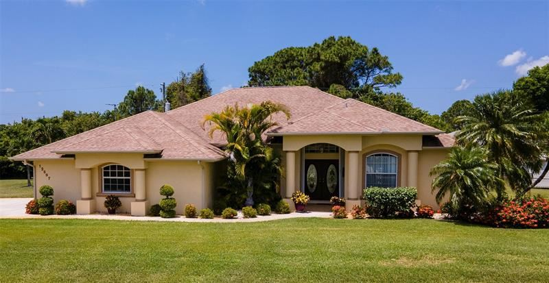 Photo of 12697 BACCHUS ROAD, PORT CHARLOTTE, FL 33981 (MLS # D6118540)