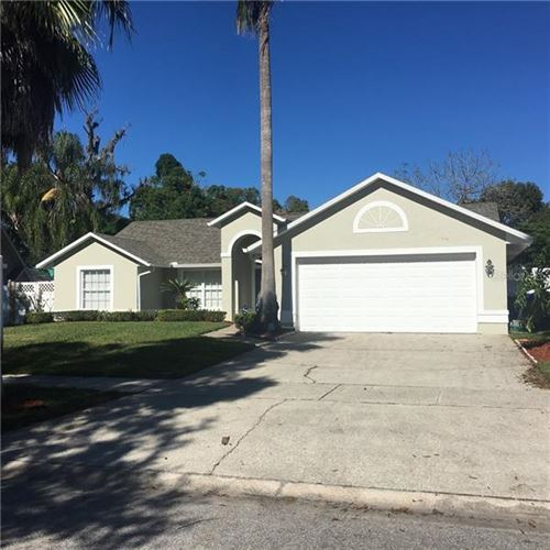 Photo of 4516 EDEN WOODS CIRCLE, ORLANDO, FL 32810 (MLS # O5826549)