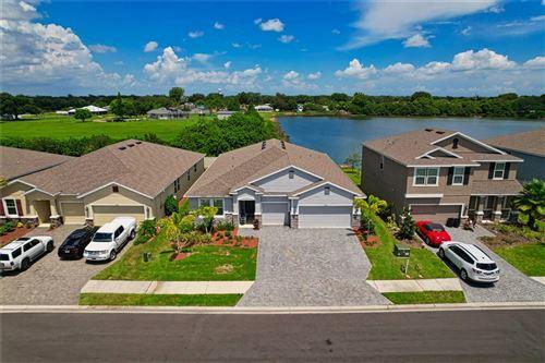 Photo of 6566 DEVESTA LOOP, PALMETTO, FL 34221 (MLS # A4507553)