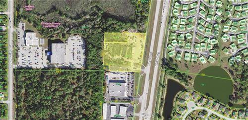 Photo of 1185 KINGS HIGHWAY, PORT CHARLOTTE, FL 33980 (MLS # C7405553)