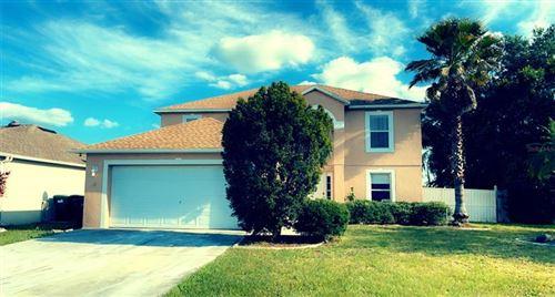 Photo of 11304 CAMUS LANE, ORLANDO, FL 32824 (MLS # O5944555)