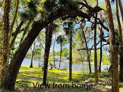 Photo of 1185 PINEY WOODS TRAIL, OSTEEN, FL 32764 (MLS # O5938556)