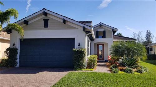 Photo of 5021 LAKE OVERLOOK AVENUE, BRADENTON, FL 34208 (MLS # A4486559)