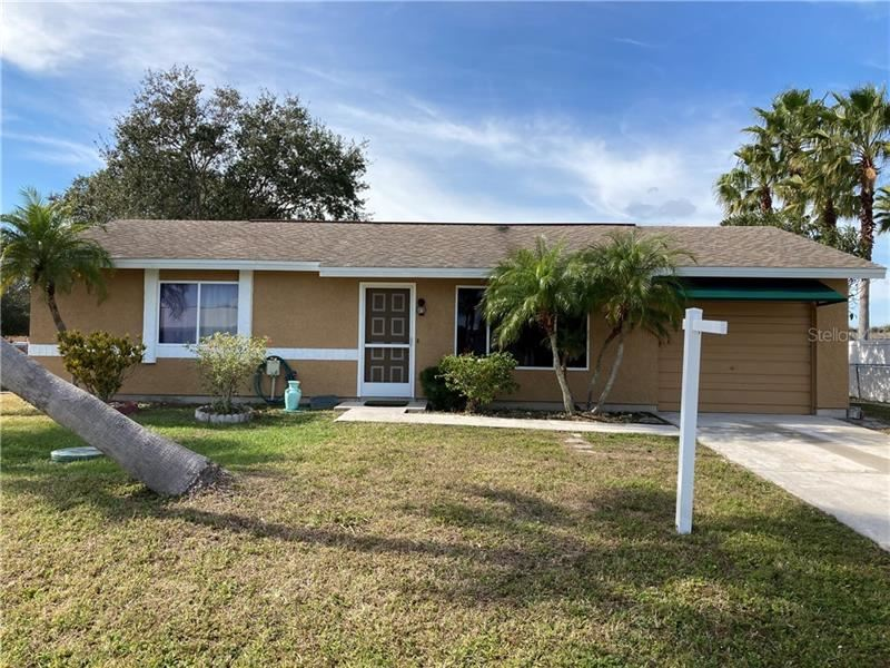 Photo of 5201 CHAVES CIRCLE, PORT CHARLOTTE, FL 33948 (MLS # C7437561)