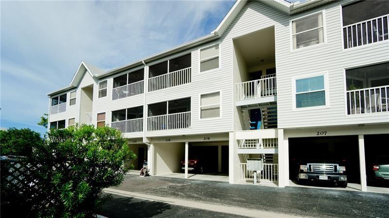 Photo of 3601 E BAY DRIVE #108, HOLMES BEACH, FL 34217 (MLS # A4456563)