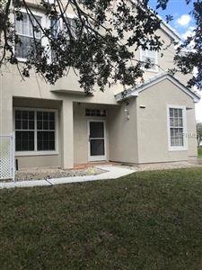 Photo of 7039 DELLA DR #2, ORLANDO, FL 32819 (MLS # O5564567)