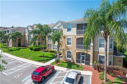 Photo of 2302 BUTTERFLY PALM WAY #301, KISSIMMEE, FL 34747 (MLS # O5857567)