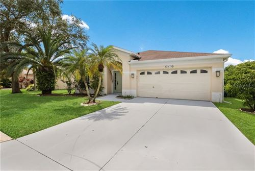 Photo of 4940 BREAKWATER DRIVE, BRADENTON, FL 34203 (MLS # A4478574)