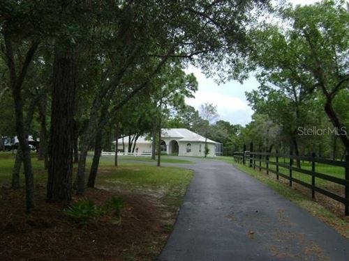 Photo of 14850 FAMILY TRAIL, HUDSON, FL 34669 (MLS # O5924575)