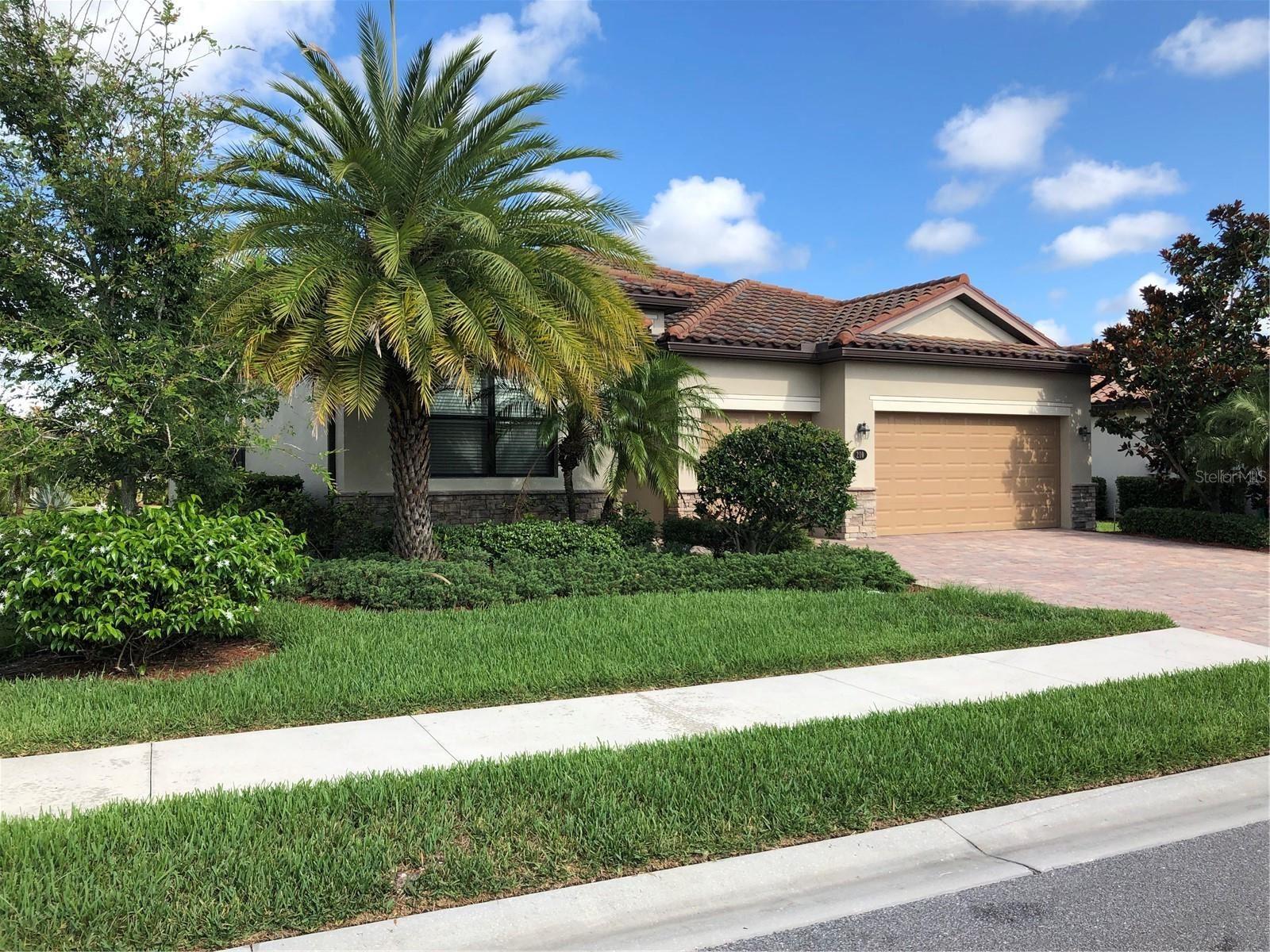 Photo of 210 WHISPERING PALMS LANE, BRADENTON, FL 34212 (MLS # A4503575)