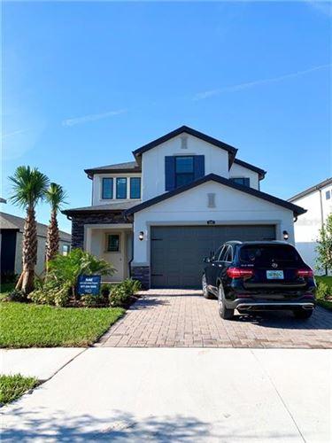 Photo of 4861 TRAMANTO LANE, WESLEY CHAPEL, FL 33543 (MLS # J917577)