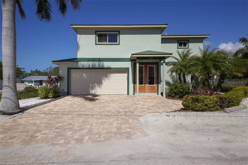 Photo of 405 20TH PL N, BRADENTON BEACH, FL 34217 (MLS # A4428580)