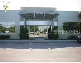 Photo of 8810 COMMODITY CIRCLE #27, ORLANDO, FL 32819 (MLS # O5940583)