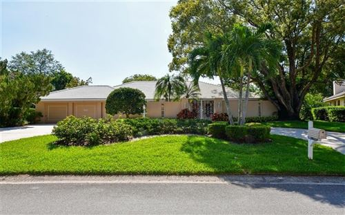 Photo of 6936 COUNTRY LAKES CIRCLE, SARASOTA, FL 34243 (MLS # A4464589)