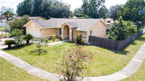 Photo of 7453 HERRICKS LOOP, ORLANDO, FL 32835 (MLS # G5041590)
