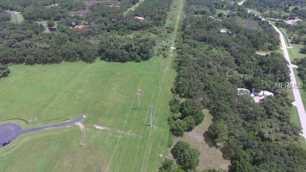 Photo of 10001 RUFFLED FERN LANE, SARASOTA, FL 34241 (MLS # A4408595)