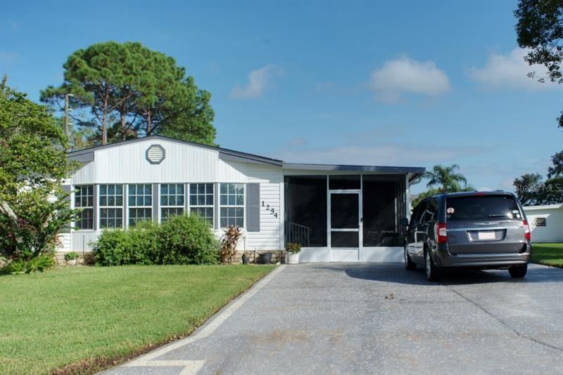 1254 BELMONT CIRCLE, Tavares, FL 32778 - #: G5034602