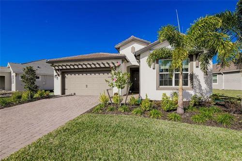 Photo of 8648 SUNDANCE LOOP, SARASOTA, FL 34238 (MLS # A4487606)