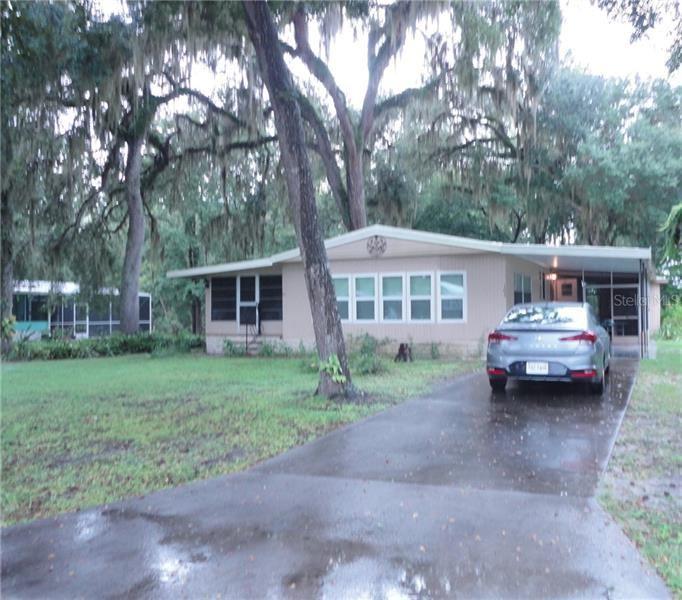 103 S HONEYSUCKLE DRIVE, Wildwood, FL 34785 - #: U8099607
