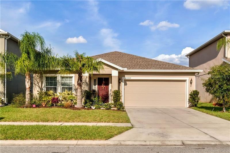 Photo of 10989 INSIDE LOOP, ORLANDO, FL 32825 (MLS # O5900608)