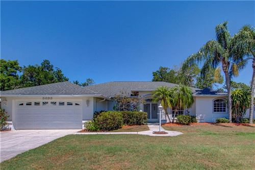 Photo of 5693 COUNTRY WALK LANE, SARASOTA, FL 34233 (MLS # A4464609)